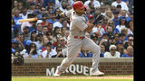 St. Louis Cardinals' Yadier Molina (4) hits a two-RBI single during the sixth inning of a baseball game against the Chicago Cubs, Friday, Sept. 20, 2019, in Chicago. (AP Photo/Matt Marton)