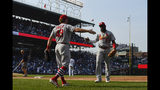 St. Louis Cardinals' Harrison Bader (48) slaps hands with Marcell Ozuna (23) after Ozuna caught a fly ball hit by Chicago Cubs' Kris Bryant to end the seventh inning of a baseball game Friday, Sept. 20, 2019, in Chicago. (AP Photo/Matt Marton)