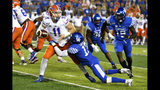Kentucky linebacker DeAndre Square (17) tries to bring down Florida quarterback Kyle Trask (11) during the second half of an NCAA college football game in Lexington, Ky., Saturday, Sept. 14, 2019. (AP Photo/Timothy D. Easley)