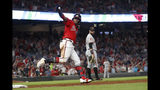 Atlanta Braves center fielder Ronald Acuna Jr. (13) reacts as he rounds first base after hitting a two-run home run in the fifth inning of a baseball game against the San Francisco Giants, Friday, Sept. 20, 2019, in Atlanta. (AP Photo/John Bazemore)