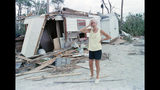 FILE- In this Sept. 23, 1989 file photo, Lou de Liesseline pauses in despair after looking at the damage to her home on Folly Beach. The water surge caused by Hurricane Hugo moved the house off its foundations and back 100 feet. Hurricane Hugo might have been the first modern U.S. storm ushering in an era of live TV coverage and large scale coastal evacuations. (AP Photo/J. Scott Applewhite, File)
