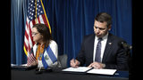 Acting Secretary of Homeland Security Kevin McAleenan signs an agreement with El Salvador Foreign Affairs Minister Alexandra Hill during news conference at the U.S. Customs and Border Protection headquarters in Washington, Friday, Sept. 20, 2019. (AP Photo/Pablo Martinez Monsivais)