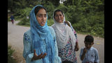 """Maryam Rasool, wife of a Kashmiri prisoner Aamir Parviaz Rather who is lodged in Agra Central Jail, speaks with the Associated Press after meeting her husband, as her mother-in-law cries in Agra, India, Friday, Sept. 20, 2019. Rather was picked up by the armed forces on the morning of Aug. 6 and held in various jails in Kashmir before being moved to Agra. The family was seeing him for the first time in 48 days. """"We hugged each other and cried. His face was swollen because of the heat. If they keep him for long, he won't survive,"""" Maryam said, tugging her 5-year-old son closely to her. (AP Photo/Altaf Qadri)"""