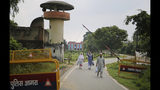 Kashmiris leave the Agra Central Jail premise after meeting a relative lodged in the jail, in Agra, India, Friday, Sept. 20, 2019. Families from the Himalayan region of Kashmir have traveled nearly 1,000 kilometers (600 miles) in sweltering heat to meet relatives being held in an Indian jail in the city of Agra. At least 4,000 people, mostly young men, have been arrested in Indian-held Kashmir since the government of Prime Minister Narendra Modi imposed a security clampdown and scrapped the region's semi-autonomy on Aug. 5, according to police officials and records reviewed by AP. (AP Photo/Altaf Qadri)