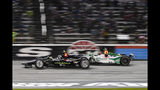 FILE - In this June 8, 2019, file photo, Josef Newgarden (2) battles Alexander Rossi (27) for position during an IndyCar auto race at Texas Motor Speedway, in Fort Worth, Texas. Newgarden can win his second IndyCar championship in three years in the season finale at historic Laguna Seca on Sunday. Newgarden leads Rossi in the standings. (AP Photo/Randy Holt, File)