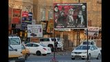 In this Wednesday, Sept. 18, 2019 photo, a billboard depicting Shiite spiritual leaders and volunteer fighters from the Iran-backed Popular Mobilization Forces who were killed in Iraq fighting Islamic State militants, is displayed in Basra, Iraq. As the U.S. and Israel step up their efforts to contain Iran, countries in Tehran's orbit are feeling the heat. Nowhere is that being felt more than in Iraq, where Shiite forces tied to Iran pose a growing challenge to the government's authority. (AP Photo/Nabil al-Jurani)