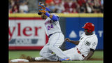 Cincinnati Reds' Aristides Aquino, right, steals second against New York Mets second baseman Robinson Cano (24) in the fourth inning of a baseball game, Friday, Sept. 20, 2019, in Cincinnati. (AP Photo/John Minchillo)