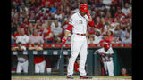 Cincinnati Reds' Joey Votto reacts after striking out against New York Mets starting pitcher Jacob deGrom to close the third inning of a baseball game, Friday, Sept. 20, 2019, in Cincinnati. (AP Photo/John Minchillo)