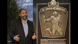 "FILE - In this Dec. 22, 2012, file photo, former Pittsburgh Steelers Hall of Fame running back Franco Harris stands on the spot of the ""Immaculate Reception"" after a marker commemorating the 40th anniversary of the play was unveiled where Three Rivers Stadium once stood on the North Side of Pittsburgh. Harris' scoop of a deflected pass and subsequent run for the winning touchdown in a 1972 playoff victory against Oakland _ has been voted the greatest play in NFL history. A nationwide panel of 68 media members chose the Immaculate Reception as the top play with 3,270 points and 39 first-place votes. (AP Photo/Gene J. Puskar, File)"