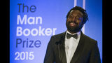 """FILE - In this Oct. 13, 2015 file photo, Marlon James, author of """"A Brief History of Severn Killings"""", speaks after being named as the winner of the Man Booker Prize for Fiction 2015, in London. Colson Whitehead's brutal narrative of a boys' reform school, """"The Nickel Boys,"""" and James' fantasy epic """"Black Leopard, Red Wolf"""" are among the works chosen by judges, Friday, Sept. 20, 2019 for the fiction longlist of the National Book Awards. (Neil Hall/Pool via AP, File)"""