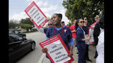 "Nurse Alexandra Rene carries a sign reading ""Patients are our Priority"" during a one-day strike outside of Palmetto General Hospital, Friday, Sept. 20, 2019, in Hialeah, Fla. Registered nurses staged a one-day strike against Tenet Health hospitals in Florida, California and Arizona on Friday, demanding higher wages and better working conditions. (AP Photo/Lynne Sladky)"