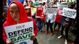 """Environmental activists hold placards during a rally outside the Department of Environment and Natural Resources to coincide with the global protests on climate change Friday, Sept. 20, 2019 at suburban Quezon city, northeast of Manila, Philippines. Various environmental groups in the country are participating in what is expected to be the world's largest mobilization on climate change known as """"Global Climate Strikes."""" (AP Photo/Bullit Marquez)"""
