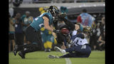 Tennessee Titans cornerback Adoree' Jackson (25) fumbles the football after getting hit by Jacksonville Jaguars defensive back Andrew Wingard (42) and defensive back Cody Davis (22) during the first half of an NFL football game Thursday, Sept. 19, 2019, in Jacksonville, Fla. (AP Photo/Phelan Ebenhack)