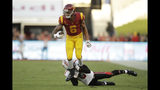 Southern California wide receiver Michael Pittman Jr. (6) is tackled by Utah defensive back Tareke Lewis during the first half of an NCAA college football game Friday, Sept. 20, 2019, in Los Angeles. (AP Photo/Marcio Jose Sanchez)