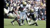 Vanderbilt running back Ke'Shawn Vaughn, center, runs between Purdue safety Jalen Graham, right, and cornerback Simeon Smiley, left, during the first half of an NCAA college football game in West Lafayette, Ind., Saturday, Sept. 7, 2019. (AP Photo/Michael Conroy)