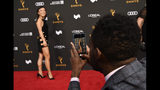 Actor William Jackson Harper, right, shoots a picture of his date, actress Ali Ahn, on the red carpet at the Performers Nominee Reception for Sunday's 71st Primetime Emmy Awards, Friday, Sept. 20, 2019, in Beverly Hills, Calif. (Photo by Chris Pizzello/Invision/AP)