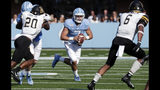 North Carolina quarterback Sam Howell (7) runs against Appalachian State's Noel Cook (20) and Desmond Franklin (6) during the second quarter of an NCAA college football game in Chapel Hill, N.C., Saturday, Sept. 21, 2019. (AP Photo/Chris Seward)