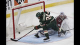 Minnesota Wild's Mats Zuccarello scores against Colorado Avalanche's goalie Pavel Francouz during the third period of an NHL preseason hockey game Saturday, Sept. 21, 2019, in St. Paul, Minn. (AP Photo/Stacy Bengs)