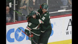 Minnesota Wild's Mats Zuccarello (36) celebrates with Jordan Greenway (18) after Zuccarello scored against the Colorado Avalanche during the third period of an NHL preseason hockey game Saturday, Sept. 21, 2019, in St. Paul, Minn. (AP Photo/Stacy Bengs)