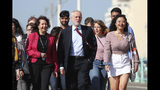 Labour Party leader Jeremy Corbyn, walking along the promenade, arrives for the Labour Party Conference at the Brighton Centre in Brighton, England. Saturday Sept. 21, 2019. (Gareth Fuller/PA via AP)