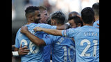 Manchester City's Riyad Mahrez, left, celebrates with teammates after scoring his sides third goal during the English Premier League soccer match between Manchester City and Watford at Etihad stadium in Manchester, England, Saturday, Sept. 21, 2019. (AP Photo/Rui Vieira)