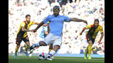 Manchester City's Sergio Aguero scores his sides second goal from a penalty spot during the English Premier League soccer match between Manchester City and Watford at Etihad stadium in Manchester, England, Saturday, Sept. 21, 2019. (AP Photo/Rui Vieira)