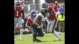 California quarterback Chase Garbers (7) is sacked by Mississippi defensive back Myles Hartsfield (15) and Mississippi linebacker Charles Wiley (99) at Vaught-Hemingway Stadium in Oxford, Miss. on Saturday, September 21, 2019. California won 28-20. (Bruce Newman/Oxford Eagle via AP)