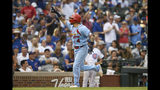 Yadier Molina de los Cardenales de San Luis festeja al recorrer las bases tras batear un jonrón en el noveno inning ante los Cachorros de Chicago, el sábado 21 de septiembre de 2019. (AP Foto/Paul Beaty)
