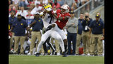 CORRECTS SCORE TO 35-14-Wisconsin linebacker Spencer Lytle, right, breaks up a pass intended for Michigan wide receiver Tarik Black during the second half of an NCAA college football game Saturday, Sept. 21, 2019, in Madison, Wis. Wisconsin won 35-14. (AP Photo/Andy Manis)