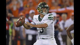 Charlotte quarterback Chris Reynolds drops back to pass during the first half of the team's NCAA college football game against Clemson on Saturday, Sept. 21, 2019, in Clemson, S.C. (AP Photo/Richard Shiro)