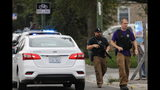 Police search for a suspect that shot a Chicago Police Department officer, near 63rd and Damen, Saturday, Sept. 21, 2019. The shooting happened around 8:40 a.m. (Abel Uribe/Chicago Tribune via AP)