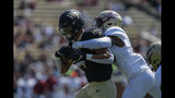 Wake Forest wide receiver Sage Surratt, left, fights for yards as Elon defensive back Daniel Reid-Bennett tries to make the tackle in the first half of an NCAA college football game in Winston-Salem, N.C., Saturday, Sept. 21, 2019. (AP Photo/Nell Redmond)
