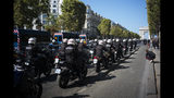 Motorcycle police officers drive along the Champs Elysees during a yellow vests demonstration, in Paris, Saturday, Sept 21. 2019. Paris police have used tear gas to disperse anti-government demonstrators who try to revive the yellow vest movement in protest at perceived economic injustice and French President Emmanuel Macron's government. The French capital was placed under high security as few hundred anti-government protesters started marching in the Paris streets. (AP Photo/Kamil Zihnioglu)