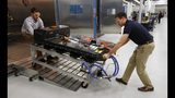 FILE- In this Nov. 4, 2016, file photo, a Chevrolet Bolt EV battery pack is removed for testing after undergoing charging and discharging cycles at General Motors Warren Technical Center's Advanced Energy Center in Warren, Mich. If U.S. consumers ever ditch fuel burners for electric vehicles, then the United Auto Workers union is in trouble. Gone would be thousands of jobs at engine and transmission plants across the industrial Midwest, replaced by smaller workforces at squeaky-clean mostly automated factories that mix up chemicals to make batteries. (AP Photo/Duane Burleson, File)