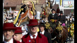 A young lady waves during a parade as part of the opening of the 186th 'Oktoberfest' beer festival in Munich, Germany, Saturday, Sept. 21, 2019. (AP Photo/Matthias Schrader)
