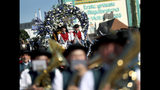 People in traditional costumes on a horse cart take part in a parade as part of the opening of the 186th 'Oktoberfest' beer festival in Munich, Germany, Saturday, Sept. 21, 2019. (AP Photo/Matthias Schrader)