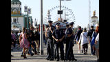 Police officers stand guard as visitors enter the 186th 'Oktoberfest' beer festival in Munich, Germany, Saturday, Sept. 21, 2019. (AP Photo/Matthias Schrader)