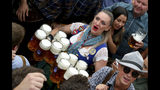 A waitress holds twelve glasses of beer during the opening of the 186th 'Oktoberfest' beer festival in Munich, Germany, Saturday, Sept. 21, 2019. (AP Photo/Matthias Schrader)
