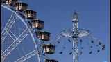 Visitors sit in a carousel during the first day of the 186th 'Oktoberfest' beer festival in Munich, Germany, Saturday, Sept. 21, 2019. (AP Photo/Matthias Schrader)