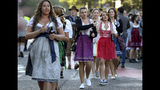 Young women arrive for the opening of the 186th 'Oktoberfest' beer festival in Munich, Germany, Saturday, Sept. 21, 2019. (AP Photo/Matthias Schrader)