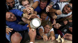 People reach out for a glass of beer during the opening of the 186th 'Oktoberfest' beer festival in Munich, Germany, Saturday, Sept. 21, 2019. (AP Photo/Matthias Schrader)
