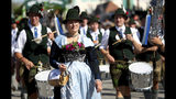 Musicians in traditional costumes take part in a parade as part of the opening of the 186th 'Oktoberfest' beer festival in Munich, Germany, Saturday, Sept. 21, 2019. (AP Photo/Matthias Schrader)