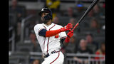 Atlanta Braves' Adeiny Hechavarria watches his line drive double to left field during the second inning of a baseball game against the San Francisco Giants, Saturday, Sept. 21, 2019, in Atlanta. Two runs scored on the play. (AP Photo/John Amis)