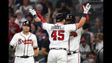 Atlanta Braves' Francisco Cervelli (45) celebrates his two-run home run at home plate with Adeiny Hechavarria during the fifth inning of a baseball game against the San Francisco Giants, Saturday, Sept. 21, 2019, in Atlanta.(AP Photo/John Amis)