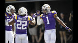 LSU wide receiver Ja'Marr Chase (1) celebrates with running back Clyde Edwards-Helaire (22) after Chase scored a touchdown on a 51-yard pass play against Vanderbilt in the first half of an NCAA college football game Saturday, Sept. 21, 2019, in Nashville, Tenn. (AP Photo/Mark Humphrey)