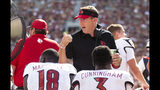 Louisville head coach Scott Satterfield talks to Louisville quarterback Malik Cunningham (3) and wide receiver Justin Marshall (18) in the first half of an NCAA college football game against Florida State, in Tallahassee, Fla., Saturday, Sept. 21, 2019.