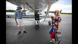 Bill Finn, safety officer and Lowcountry Flight Club flight instructor, talks with Wendy Diaz at the Berkeley County Airport after her flight on Saturday, Aug. 24, 2019. (Lauren Petracca/The Post And Courier via AP)