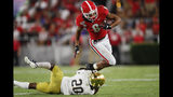 Notre Dame cornerback Shaun Crawford (20) tackles Georgia wide receiver Dominick Blaylock (8) during the first half of an NCAA college football game, Saturday, Sept. 21, 2019, in Athens, Ga. (AP Photo/John Bazemore)