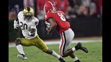 Georgia wide receiver Dominick Blaylock (8) runs near Notre Dame cornerback Shaun Crawford (20) during the first half of an NCAA college football game, Saturday, Sept. 21, 2019, in Athens, Ga. (AP Photo/Mike Stewart)