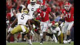 Georgia running back D'Andre Swift (7) drags Notre Dame safety Jalen Elliott (21) during the first half of an NCAA college football game, Saturday, Sept. 21, 2019, in Athens, Ga. (AP Photo/John Bazemore)